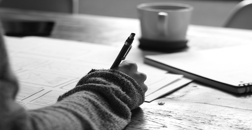 Photo of hand holding a pen